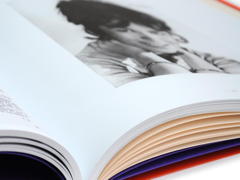 Different paper stock was used for the pages of photographs and the caption pages